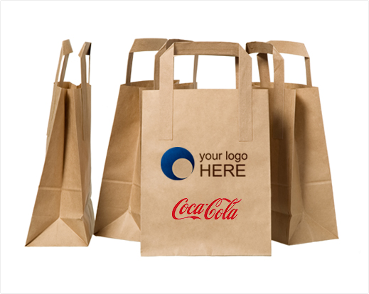 Four printed paper bags with Coca-Cola logo and one sample logo.