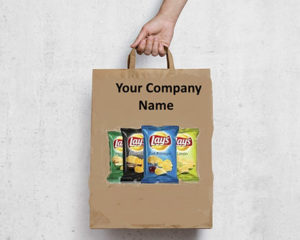 A hand holding a brown paper bag with handles, printed with a product image of Lay's chips.